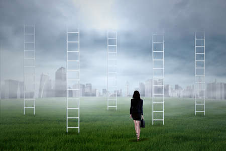 the view option: Businesswoman looking for new business journey to the city Stock Photo