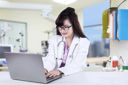 asian medical: Female doctor working on laptop in hospital