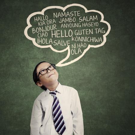 education concept: Education concept: schoolboy learn multilanguage at class