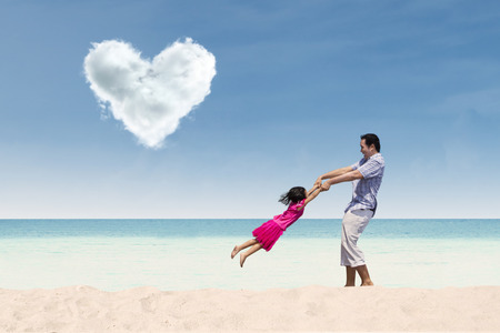 under heart: Happy time with dad under heart cloud at the beach
