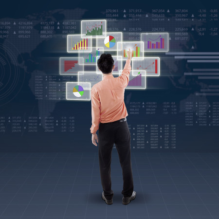 man behind: Back view of businessman choose and touch business chart on futuristic interface