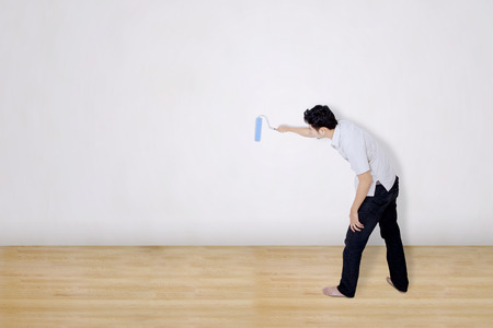 painting and decorating: Man painting on white background