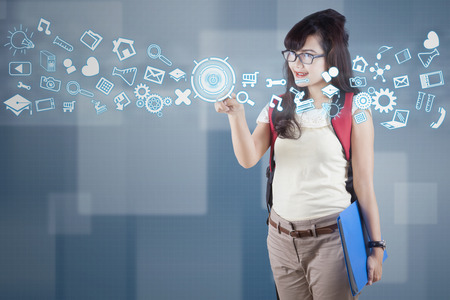 accessing: Female student using futuristic interface for accessing information