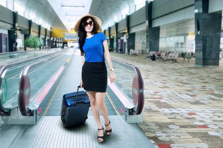 chinese woman: Woman with a suitcase standing in airport Stock Photo