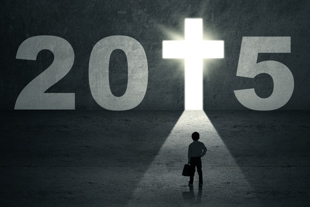 jesus standing: Boy standing on the way and looking at a future door with number 2015 Stock Photo