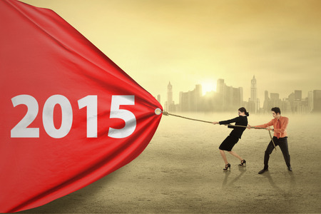 Business people try to make a change by dragging number 2015 photo
