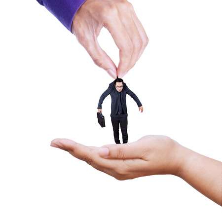 Hand giving a businessman to other hand, isolated on white background photo
