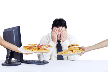 refuse: Overweight worker covering his face and refuse to eat fast food, isolated on white background Stock Photo