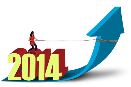 Asian woman is pulling 2014 with chain on white background photo