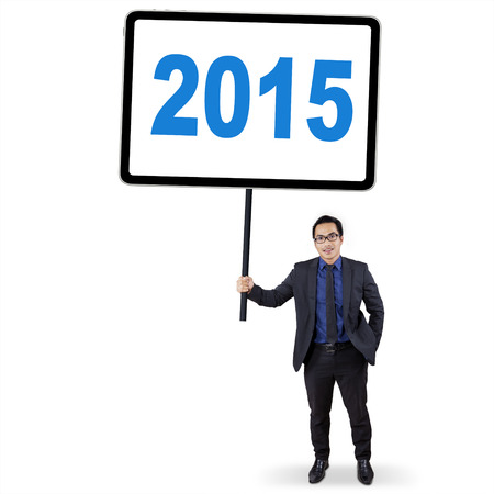 Young asian manager holding a whiteboard with number 2015, isolated on white background photo