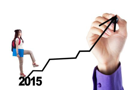 year increase: Beautiful female student go upward on the graph