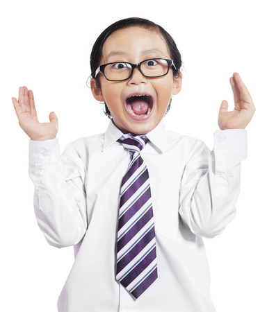 Portrait of little boy in business suit with shocked expression, isolated on white background