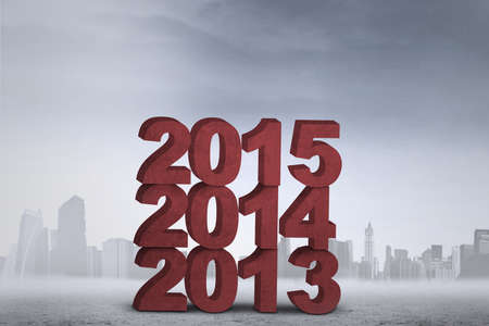 each year: Pile of numbers 2013, 2014, and 2015, shot outdoors symbolizing improvement each year