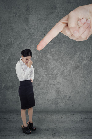 scolded: Full length of businesswoman having pressure and get headache after scolded by someone Stock Photo