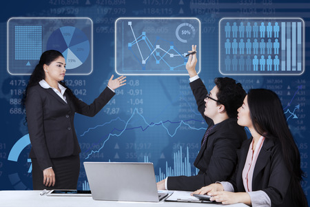 asian business team: Male employee raising hand and inquiring on his manager when meeting together in the office