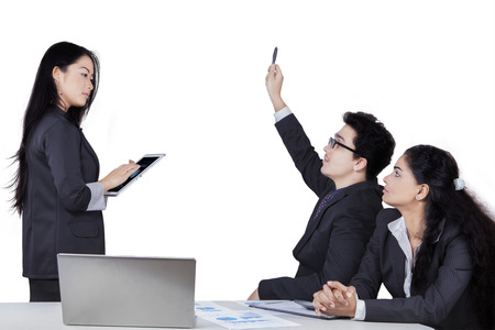 enquire: Portrait of caucasian businessman raise hand to ask at the meeting leader, isolated on white