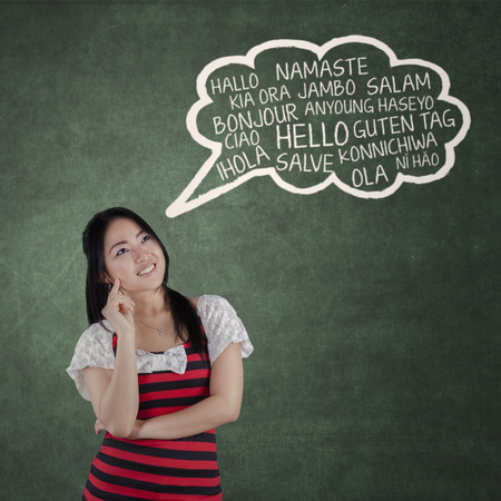 multilingual: Portrait of young chinese woman studying multilingual in the class Stock Photo