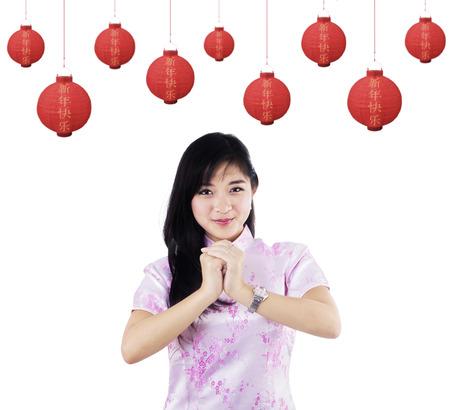 chinese dress: Beautiful woman celebrating chinese new year Stock Photo