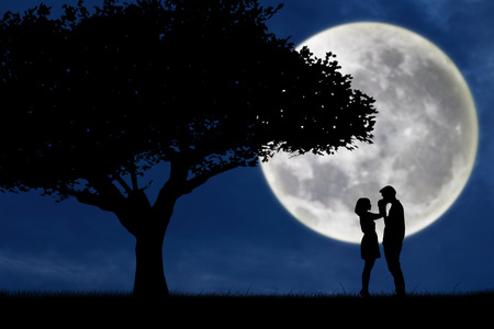 back to back couple: Guy kiss girl hand on full moon silhouette background