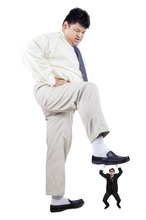 trample: Big businessman trample a little businessperson, symbolizing business competition