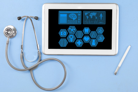 Closeup of stethoscope with medical icons on the digital tablet screen and stylus pen photo