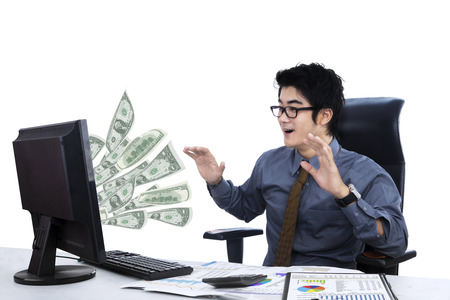 Lucky businessman getting money from the internet online photo