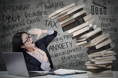 work book: Stressed businesswoman with collapse books and job problems