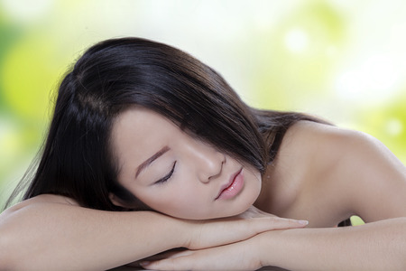 hair treatment: Portrait of beautiful young woman with perfect skin and hair, taking a rest after skin treatment