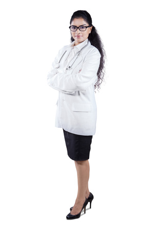 Full length portrait of happy female doctor standing in coat smiling at camera photo