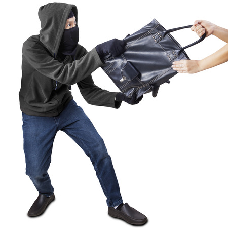 pickpocket: Male robber robbing a handbag of woman, isolated on white background