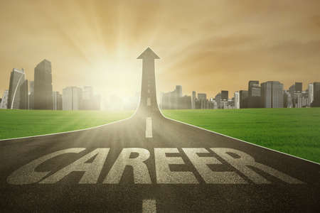 career: Highway with career text rising upward with sunrise in the morning, symbolizing the way to the bright career