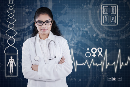 Portrait of an indian doctor looking at the camera with confident expression in front of medical futuristic screen photo