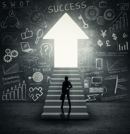 success asian: Businesswoman standing on the stairs and looking at bright door Stock Photo
