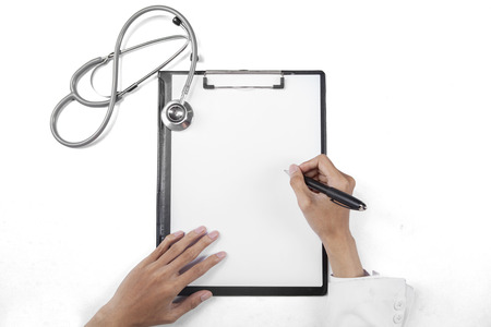 General doctor hands writing a prescription on the empty paper over clipboard photo