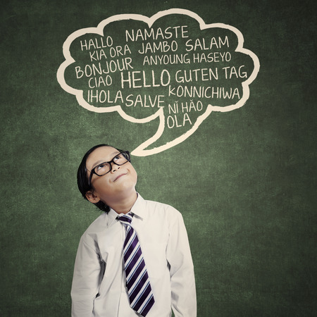 Education concept: schoolboy learn multilanguage at class