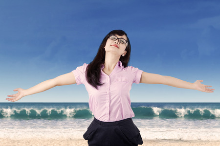 stress free: Carefree woman is stress free and holds her arms out for freedom and peace of mind.