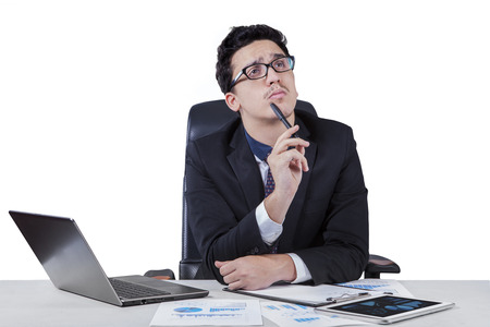 Young worker concentrate to make a solution while working with laptop on desk, isolated on white background photo