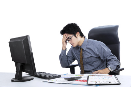 computer problem: Young businessman stressful in the office
