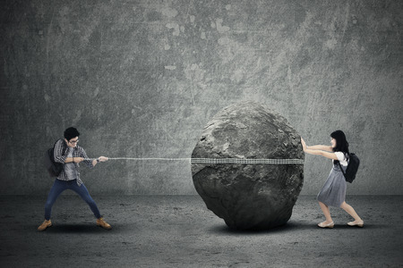 pulling money: Education problem with students pulling and pushing heavy stone