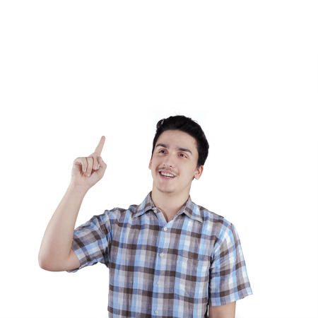 got: Portrait of young caucasian man wearing casual shirt and expressing got idea