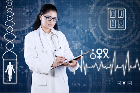 Female general doctor standing in front of futuristic interface while writing prescription on clipboard photo