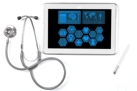 Closeup of medical tablet showing medical symbols on the screen with stethoscope photo