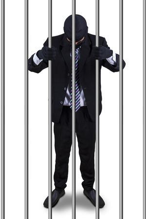 culpable: Male manager standing in the prison as the prisoner, isolated on white