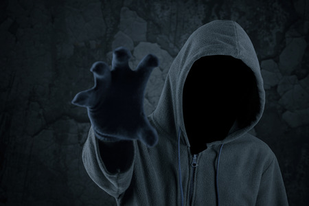 horrifying: Mysterious robber try to grab something with his hand and looks scary