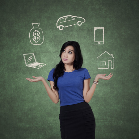 Beautiful female entrepreneur juggling her wish and confused to choose one of the wish