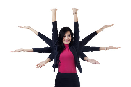 Young asian entrepreneur with eight hands to work, symbolizing multitasking businesswoman 写真素材