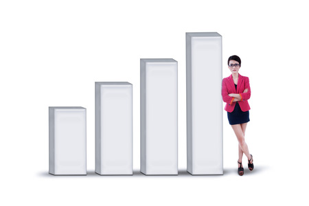 Businesswoman standing next to profit bar chart on white background photo