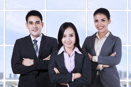 Confident business people looking at camera smiling Stock Photo