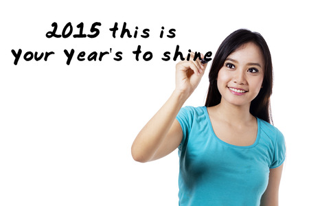 better chances: Young woman writes an advice word for shine in 2015
