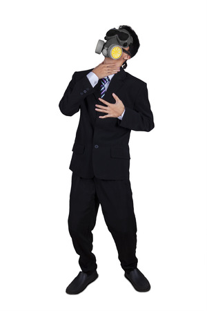 stifle: Businessperson wearing a gas mask and fail to breathe, isolated on white background Stock Photo